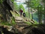 Riders ascending rocks.