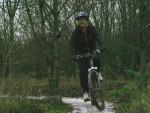 Woman riding mountain bike.