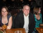 Man sat between two women.