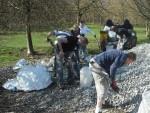 Group of volunteers moving gravel.