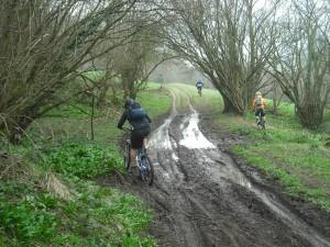 Riding along track with lage puddle.