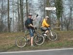 """Mountain bikers next to sign saying """"steep hill""""."""