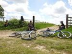 Three mountain bikers having a rest.