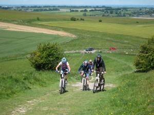 Riding up hill near Barbury Castle in Wiltshire.