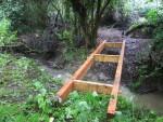 Wooden bridge for mountain bike trail.