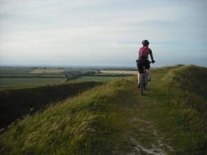 Mountain bike rider at Barbury Castle near Swindon.