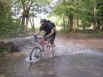 Rider in water splash near Castle Combe.
