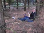 Man sitting under a tree in the Croft Woods in Swindon.