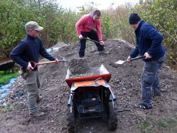 Moving limestone chippings at a trail build day.