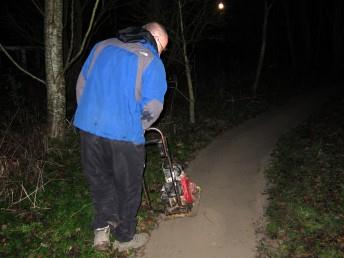 Compacting chippings by dark at the Croft Trail in Swindon.