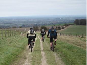 Mountain bikers on the ridgeway in Wiltshire.