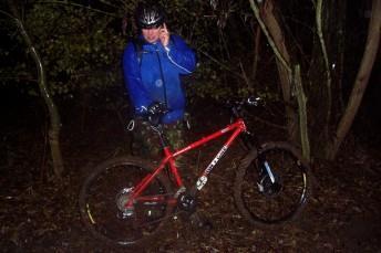Mountain bike rider in the dark and wet.