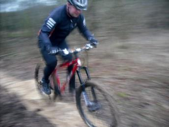 Artistic blurry photo of a mountain biker at Croft Trail in Swindon.