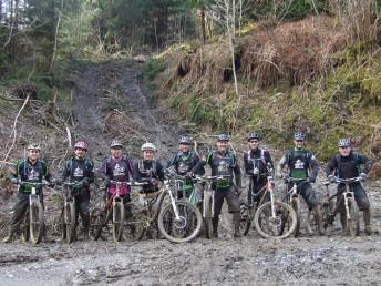 Group of muddy mountain bikers at Brechfa with Mudtrek