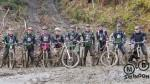 Muddy group of mountain bikers