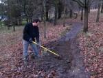 Raking mud at mountain bike trail.