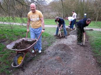 Team of volunteers building a path in Swindon.