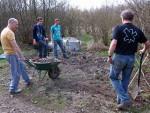 Big society team digging gravel.
