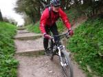 Cycling down a set of steps near Stonesfield.