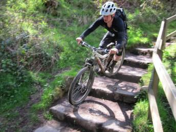 Riding a set of steps near Derwent Dam