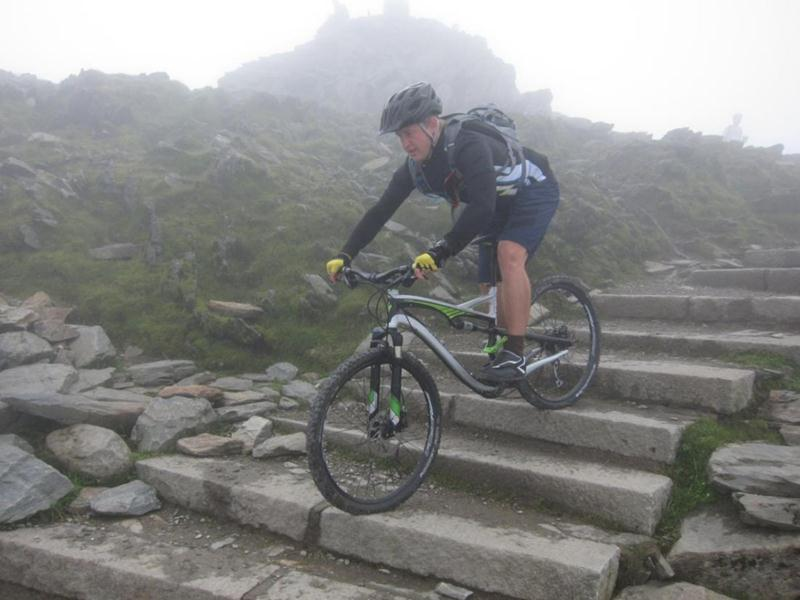 Riding down steps on Snowdon
