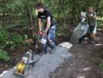 Fixing a mountain bike trail.