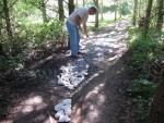 Filling pot holes at mountain bike trail.