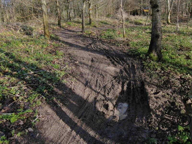 Muddy mountain bike trail
