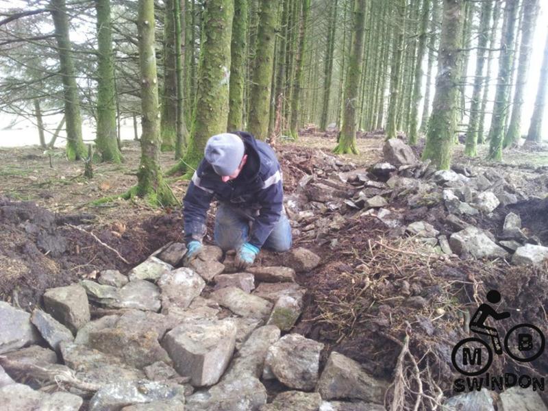 Laying rocks for a mountain bike trail.
