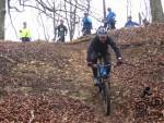 Riding down steep slope near Cranham