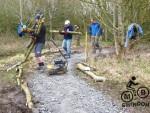 Log edging for mountain bike trail.