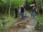 Moving logs at a mountain bike trail.