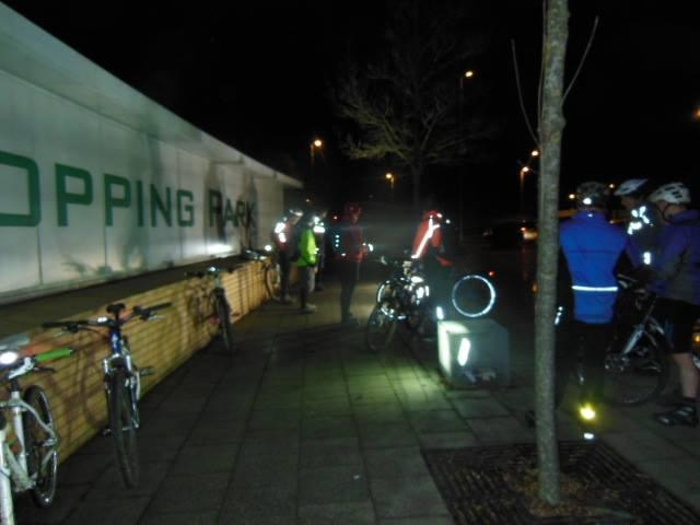 bikes and riders at the orbital shopping centre sign